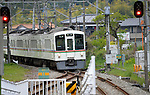 April 23, 2013, Hanno, Japan - A Seibu Railway Co.'s train bound for Hanno, some 43 km northwest of Tokyo, approaches Musashi-Yokote Station of the company's 19-km Seibu Chichibu Line on Tuesday, April 23, 2013...U.S. equity fund Cerberus Capital Management has made an tender offer to boost its stake from the present 32 percent to nearly 45 percent in an apparent bid to take the initiative in managing Seibu Holdings,  the railway and hotel operator. Rumors that the U.S. investment firm is demanding that the unprofitable local line be closed made local governor and community leaders run to Seibu Holdings to make their case to keep the line open. The six-station line, which opened in 1969, is used by about 10,000 people daily.  (Photo by Natsuki Sakai/AFLO)