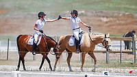 NZL-Anna Wilson (Kirralea Statesman) and Amy Vujcich (Sir Duke) high five the finish of their competition - brilliant dancing everyone! 2020 NZL-Equestrian Entries NZ Youth Dressage Festival. Sunday 26 January. Copyright Photo: Libby Law Photography