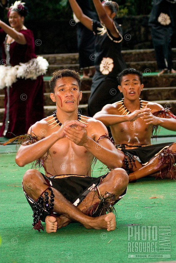 Young samoan male dancers perform at the Polynesian Cultural Center in Laie.