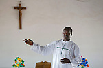 Alfred Yoroyire gives Mass at the Martyrs of Uganda Parish church in the village of Manyoro, in the Bolgatanga municipality of North Eastern Ghana..Ghana 22 January 2012.