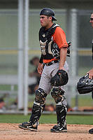 Catcher Austin Wynns (48) of the Baltimore Orioles organization during a minor league spring training camp day game on March 23, 2014 at Buck O'Neil Complex in Sarasota, Florida.  (Mike Janes/Four Seam Images)