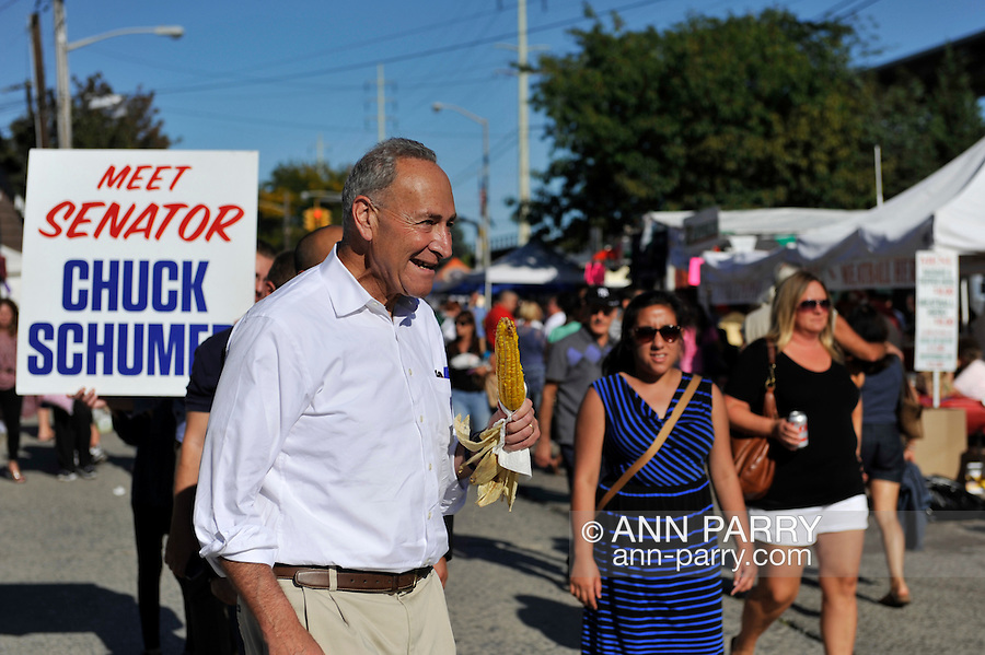 Bellmore, New York, USA. September 20, 2015. U.S. Senator CHARLES (CHUCK) SCHUMER (Democrat - New York) eats corn on the cob as he meets people during his visit to the 29th Annual Bellmore Family Street Festival, featuring family fun with exhibits and attractions, with over 100,000 people expected to attend over the weekend. The popular Nassau County fair is made possible by volunteers from the Chamber of Commerce of the Bellmores, the event host.