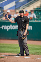 Umpire Pete Talkington handles the calls behind the plate during the game between the Ogden Raptors and the Idaho Falls Chukars at Lindquist Field on July 29, 2018 in Ogden, Utah. The Raptors defeated the Chukars 20-19. (Stephen Smith/Four Seam Images)