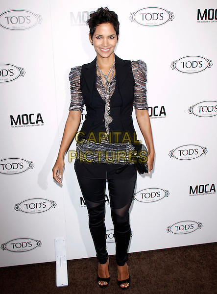 HALLE BERRY.The Diego Della Valle Cocktail Celebration Honoring Tod's Beverly Hills Boutique And MOCA's New Director Jerry Deitch at Tod's Boutique in Beverly Hills, California, USA..April 15th, 2010        .full length silver grey gray sheer puff leggings jeggings sleeve top waistcoat black vest clutch bag necklace sheer striped shiny .CAP/RKE/DVS.©DVS/RockinExposures/Capital Pictures.