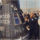 "United States President John F. Kennedy inspects interior of ""Friendship 7"" on February 23, 1962 at Hanger S, Cape Canaveral, Florida.   The President presented the NASA Distinguished Service Medal (DSM) to Astronaut Glenn.  Left to right: President Kennedy, Lieutenant Colonel John H. Glenn, Jr., others. .Mandatory Credit: Cecil Stoughton - The White House via CNP"