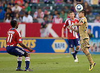 Philadelphia Union midfielder Roger Torres (20) heads a ball past CD Chivas USA midfielder Michael Lahoud (11). The Philadelphia Union and CD Chivas USA played to 1-1 draw at Home Depot Center stadium in Carson, California on Saturday evening July 3, 2010..