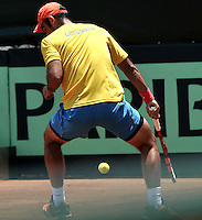 CALI - COLOMBIA – 06-04-2014: Juan Sebastian Cabal de Colombia devuelve la bola a Jose Olivares de Republica Dominicana, durante partido de la serie final de partidos en el Grupo I de la Zona Americana de la Copa Davis, partidos entre Colombia y República Dominicana en Estadio de Tenis Alvaro Carlos Jordan en la ciudad de Cali. / Juan Sebastian Cabal of Colombia returs the ball to Jose Olivares of Dominican Republic during a match to the final series of matches in Group I of the American Zone Davis Cup, match between Colombia and Dominican Republic at the Alvaro Carlos Jordan Tennis Stadium in Cali, city. Photo: VizzorImage / Luis Ramirez / Staff