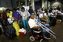 Crowds gather into the Louisiana Superdome after the mayor of New Orleans declared the city's first mandatory evacuation, as Hurricane Katrina is expected to hit the area as a Category 5 storm.<br />