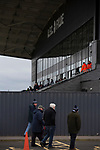 Home supporters arriving at the stadium before AFC Fylde took on Aldershot Town in a National League game at Mill Farm, Wesham. The fixture was played against the backdrop of the total postponement of all Premier League and EFL football matches due to the the coronavirus outbreak. The home team won the match 1-0 with first-half goal by Danny Philliskirk watched by a crowd of 1668.