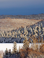 Winter falls on Oberg Lake along the superior hiking trail.