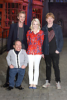 Leavesden, Herts - Members of the cast and crew - including Rupert Grint, Tom Felton, Warwick Davis, Evanna Lynch, Producer David Heyman and Director David Yates - at a photocall during a press visit/junket at 'Warners Bros Studio Tour - The Making of Harry Potter' at Leavesden Studios, Watford, Hertfordhire - March 29th 2012..Photo by Keith Mayhew