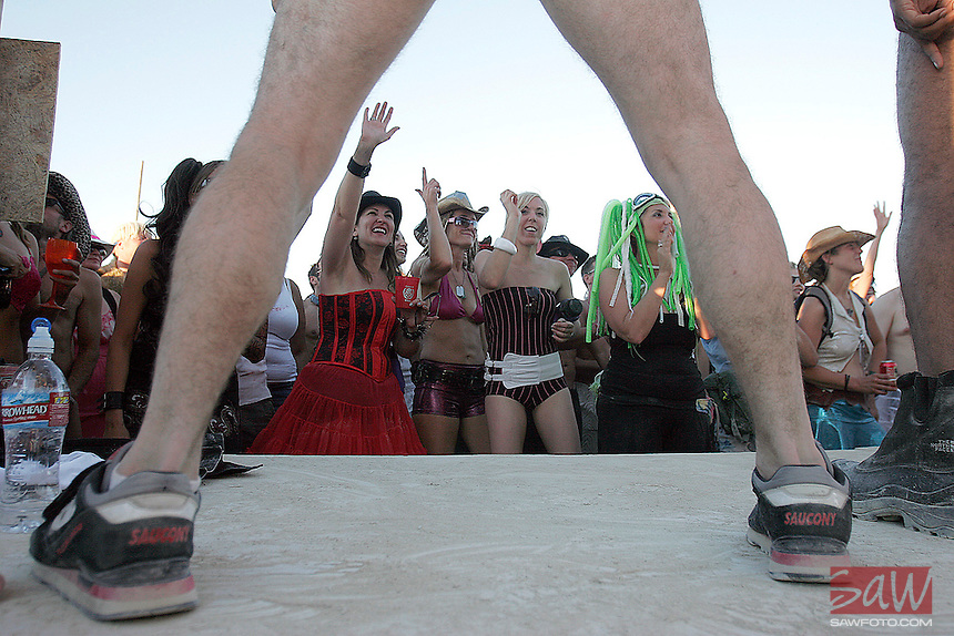 BLACK ROCK CITY,NV - AUGUST 27,2008: The Yatta dancers perform to an appreciative crowd at the Deep End Dance Camp, August 27,2008. The Burning Man Event 2008 kicked into full gear  as participants from around the world converge in Neveda for the annual art event. The event, near Gerlach, Nevada has grown from a few thousand people over 30,000 people annually.