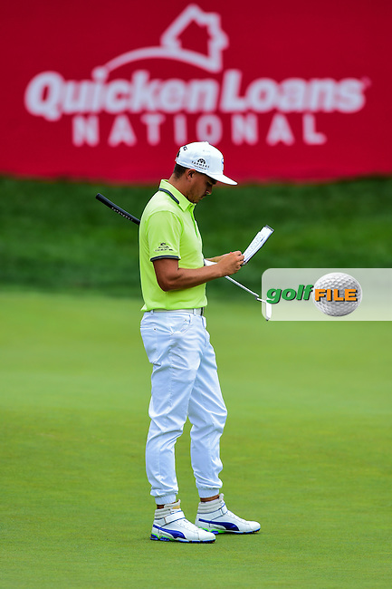 Rickie Fowler (USA) fills out his scorecard on 17 during round 2 of the 2016 Quicken Loans National, Congressional Country Club, Bethesda, Maryland, USA. 6/24/2016.<br /> Picture: Golffile | Ken Murray<br /> <br /> <br /> All photo usage must carry mandatory copyright credit (&copy; Golffile | Ken Murray)