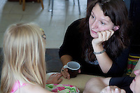 Polish mother listening to her daughter age 32 and 4. Zawady Central Poland