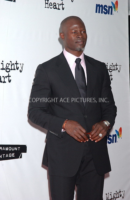 WWW.ACEPIXS.COM . . . . . ....June 13, 2007. New York City.....Actor Djimon Hounsou attends the New York premiere of 'A Mighty Heart' held at Ziegfeld Theatre.....In the movie Angelina Jolie plays Mariane Pearl, wife of slain Wall Street Journal reporter Daniel Pearl. Brad Pitt is the producer of the movie. ....Please byline: KRISTIN CALLAHAN - ACEPIXS.COM.. . . . . . ..Ace Pictures, Inc:  ..(646) 769 0430..e-mail: info@acepixs.com..web: http://www.acepixs.com
