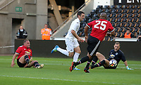 Sam Rickets of Swansea (C) scores the equaliser, making the score 2-2. during the Swansea Legends v Manchester United Legends at The Liberty Stadium, Swansea, Wales, UK. Wednesday 09 August 2017