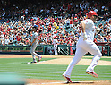 Yu Darvish (Rangers),<br /> MAY 4, 2014 - MLB :<br /> Pitcher Yu Darvish of the Texas Rangers reacts after giving up a home run to Albert Pujols of the Los Angeles Angels who rounds the bases in the first inning during the Major League Baseball game at Angel Stadium in Anaheim, California, United States. (Photo by AFLO)