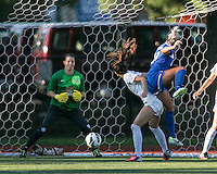 In a National Women's Soccer League Elite (NWSL) match, the Boston Breakers defeated the FC Kansas City, 1-0, at Dilboy Stadium on August 10, 2013.  Boston Breakers forward Kyah Simon (17) heads a ball past FC Kansas City midfielder/forward Erika Tymrak (15) off a corner kick.