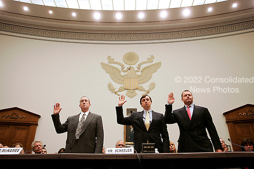 "Washington, DC - February 13, 2008 -- Roger Clemens, former New York Yankee pitcher, right, Charlie Scheeler, Investigator on Senator Mitchell's staff, center; and Brian McNamee, former Major League Baseball strength and conditioning coach, left; are sworn-in to testify before the United States House of Representatives Committee on Government Operations and Reform hearing on ""The Mitchell Report: The Illegal use of Steroids in Major League Baseball, Day 2""  concerning alleged use of steroids and human growth hormone (HGH) by Clemens and several other major league players in Washington, D.C. on Wednesday, February 13, 2008.  .Credit: Pool via CNP"