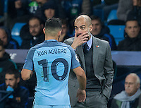 Manchester City Manager (Head Coach) Josep Guardiola looks at Sergio Aguero of Manchester City during the UEFA Champions League match between Manchester City and Barcelona at the Etihad Stadium, Manchester, England on 1 November 2016. Photo by Andy Rowland / PRiME Media Images.