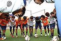 AC Nagano Parceiro team group,JULY 3, 2011 - Football / Soccer :AC Nagano Parceiro players make a circle during warm-up before the 2011 Japan Football League (JFL) match between AC Nagano Parceiro 1-1 Matsumoto Yamaga F.C. at Minami Nagano Sports Park Stadium in Nagano, Japan. (Photo by Hiroyuki Sato/AFLO)
