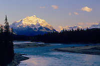 Mount Kerkeslin, moon and Athabasca River in Jasper National Park, Alberta.  Summer.