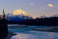 Mount Kerkeslin, moon and Athabasca River in Jasper National Park, Alberta.  Summer.