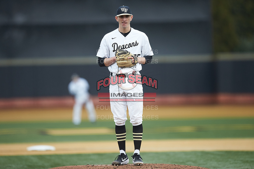Wake Forest Demon Deacons starting pitcher Morgan McSweeney (35) looks to his catcher for the sign against the Sacred Heart Pioneers at David F. Couch Ballpark on February 15, 2019 in  Winston-Salem, North Carolina.  The Demon Deacons defeated the Pioneers 14-1. (Brian Westerholt/Four Seam Images)