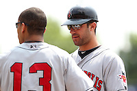 Indianapolis Indians outfielder Andrew Lambo #24 talks with Gorkys Hernandez #13 during a game against the Buffalo Bisons at Coca-Cola Field on June 9, 2011 in Buffalo, New York.  Buffalo defeated Indianapolis 15-2.  Photo By Mike Janes/Four Seam Images
