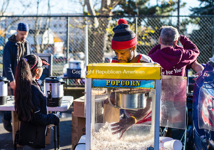 Waterbury, CT- 19 November 2016-111916CM08-  Joshua Gaskins a volunteer from Waterbury serves popcorn during a Thanksgiving Outreach in Martin Luther King Park in Waterbury on Saturday.  The event put on by Christ Church, provided food, clothing items and blankets.  Christopher Massa Republican-American