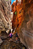 Hikers in the slot canyon, Kanarra Creek Falls, near Cedar City, Utah USA.