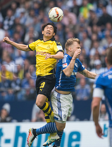 10.04.2016. Gelsenkirchen, Germany. Schalke's Johannes Geis (R) and Dortmund's Shinji Kagawa vie for the ball during the German Bundesliga soccer match between FC Schalke 04 and Borussia Dortmund at the Veltins Arena in Gelsenkirchen, Germany, 10 April 2016.
