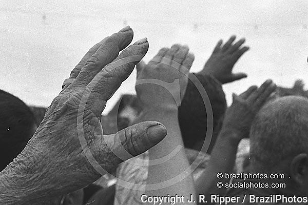 Religion. People engaged in ritual ceremony of prayer and worship. Catholicism, faith - Jubileu do Senhor Bom Jesus do Matosinhos. City: Congonhas do Campo, State: Minas Gerais; Brazil.