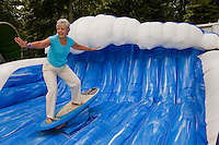 A woman tries her hand on a surfing exhibit at the Festival in the Park. For more than four decades, Charlotte's annual Festival in the Park has brought music, art and fun to Charlotteans and visitors. The festival has been chosen as one of Sunshine Artists Magazine's 200 Best Festivals.