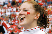 A cheerleader performs beside the field during a football game at Camp Randall Stadium.<br /> <br /> Client: University of Wisconsin-Madison<br /> &copy; UW-Madison University Communications 608-262-0067<br /> Photo by: Michael Forster Rothbart<br /> Date:  2001     File#:   color slide.