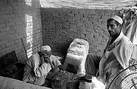 Pakistan 1986 .Darra Adamkhel is Pakistan's largest weapons bazaar and factory, renowned for its gun making expertise since the late 19th century, Darra is a sprawl of hundreds of workshops where some 3,500 gunsmiths toil on replica weapons..A forge