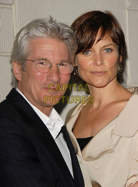 "RICHARD GERE & CAREY LOWELL.Attend The Special Screening of ""The Hoax"" held at Mann Festival Westwood in Westwood, California, USA, .March 18th 2007..portrait headshot black suit glasses beige cream coat mac.CAP/DVS.© cream coat Debbie VanStory/Capital Pictures"