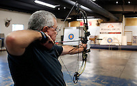 NWA Democrat-Gazette/DAVID GOTTSCHALK  Joe Baker draws back on his bow on the archery range Thursday, October 22, 2015 at Rugged Faith in Tontitown. The church offers a free archery range prior to the activities of the evening.