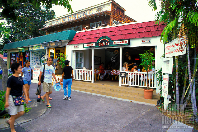 Scenes from along the waterfront in the quaint town of Kailua-Kona. Gift shops,hotels,restaurants,shave ice stands ,art galleries and more, eagerly await tourists visiting this tranquil hangout along the Kona coast of the Big Island of Hawaii.