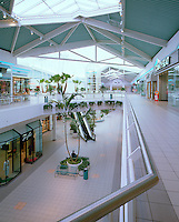 Empty shopping mall on a Sunday morning. Illustrates concept of mall under financial pressure due to lack of customers. Little Rock, Arkansas.