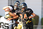 Beverly Hills, CA 09/23/11 - unknown Beverly Hills player(s) and Alex Asawa (Peninsula #35) in action during the Peninsula-Beverly Hills frosh football game at Beverly Hills High School.