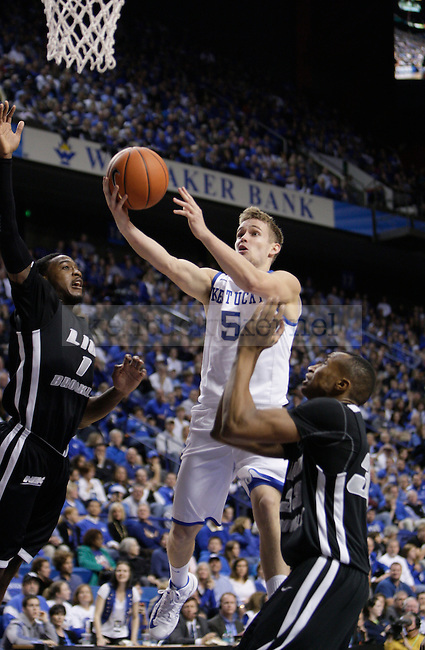 UK junior guard Jarrod Polson drives to the basket against LIU at Rupp Arena on Friday, Nov. 23, 2012. Photo by Scott Hannigan | Staff