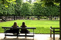 People enjoying and lrelaxing in Jardin des Tuileries Paris, France.