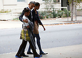 United States President Barack Obama walks from St John's Episcopal Church to the White House on Sunday, October 28, 2012. From left to right: Sasha Obama, President Obama, Malia Obama..Credit: Dennis Brack / Pool via CNP