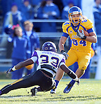 BROOKINGS, SD - OCTOBER 26:  Trevor Tiefentahaler #84 from South Dakota State University looks for room past Jeremy Johnson #33 from Northern Iowa in the third quarter of their game Saturday afternoon at Coughlin Alumni Stadium in Brookings. (Photo by Dave Eggen/Inertia)