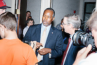Republican presidential candidate Dr. Ben Carson enters the room before speaking at a town hall campaign stop at a meeting of the Windham Republican Town Committee at the Castleton Banquet and Conference Center in Windham, New Hampshire.