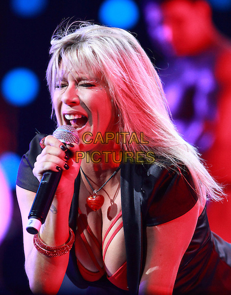 "Samantha Fox.Legends of Retro FM, ""Olympic"", Moscow, Russia..October 30th, 2010.stage concert live gig performance performing music in on half length black jacket red singing cleavage.CAP/PER/SB.©SB/PersonaStars/CapitalPictures"