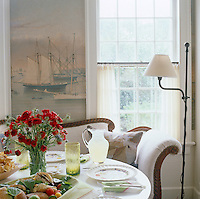 Close up of the breakfast table and Empire sofa  with a wrap-around scenic wallpaper created by enlarging a Currier & Ives print of Newport Harbour in the background
