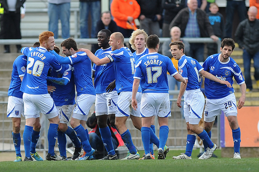 Portsmouth's Jed Wallace celebrates scoring his sides second goal with team mates<br /> <br /> Photo by Ashley Crowden/CameraSport<br /> <br /> Football - The Football League Sky Bet League Two - Newport County AFC v Portsmouth - Saturday 29th March 2014 - Rodney Parade - Newport<br /> <br /> &copy; CameraSport - 43 Linden Ave. Countesthorpe. Leicester. England. LE8 5PG - Tel: +44 (0) 116 277 4147 - admin@camerasport.com - www.camerasport.com