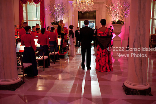 United States President Barack Obama and First Lady Michelle Obama pause in the Grand Foyer of the White House as they prepare to welcome President Hu Jintao of China for the State Dinner, Wednesday, January 19, 2011. .Mandatory Credit: Pete Souza - White House via CNP